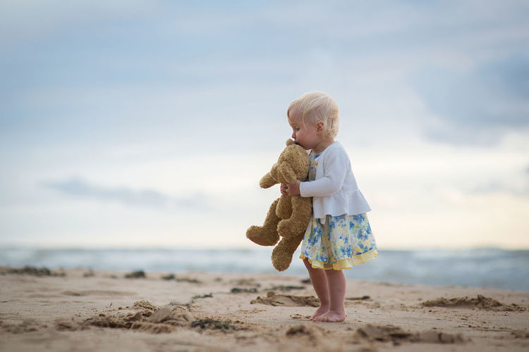 Adult Babies Only Baby Babyhood Beach Blond Hair Childhood Day Full Length Horizon Over Water Innocence Nature One Person Outdoors People Sand Sea Sky Teddy Bear