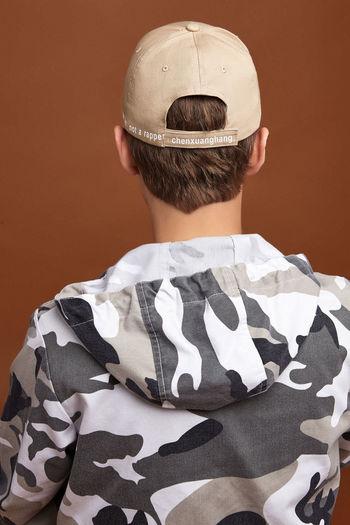 Rear view of boy wearing hat