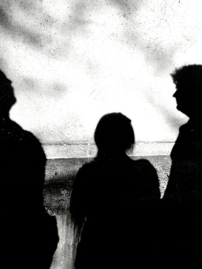 At the end of the week :)Three People Silhouette Women Real People Indoors  Togetherness Couple - Relationship Men Shadow Shadows & Lights Black And White Blackandwhite Black & White No Colors Leisure Activity Break Time Friday ✌ Smoking Day People Human Body Part Human Hand EyeEmNewHere Welcome To Black EyeEm Diversity Break The Mold The Street Photographer - 2017 EyeEm Awards Live For The Story Black And White Friday