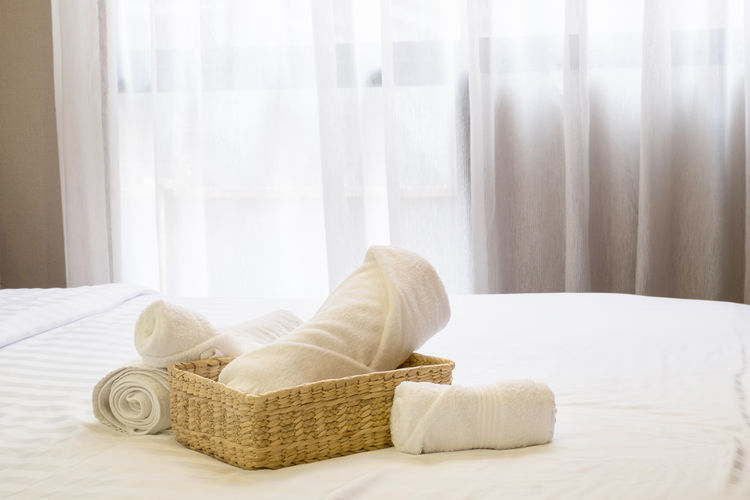 Towels With Basket On Bed