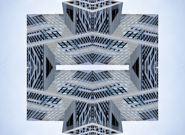Facade of modern office building mirrored four times Architecture Arrow Background Blue Copy Space Data Day Digitally Generated Directly Below Façade Gray Harmony History No People Office Building Outdoors Pattern Perspective Shape Sky Square Symmetry White White Center Windows