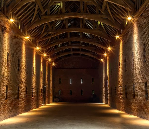 The Great Barn Arch Architectural Column Architecture Built Structure Corridor Diminishing Perspective Empty Glowing Illuminated In A Row Light Lighting Equipment Long Narrow Night No People The Way Forward Tunnel Vanishing Point Walkway