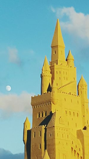 The Sandcastle On The Beach Sand Sandcastle Sunlight EyeEm Selects City Sunset Architecture Moon Tower