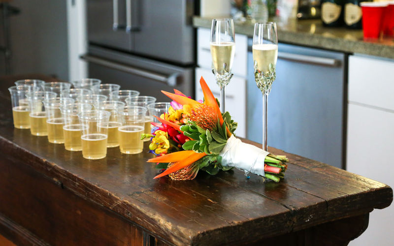 Getting ready for toast Celebration Drinks Happily Married Happy Hour Wedding Bouquet Bouquet Of Flowers Buoquet Champagne, Proesecco Close-up Colorful Colroful Drinking Glass Flower Flowers Focus On Foreground Food And Drink Kitchen Lined Up No People Serving Size Table Wedding Ceremony