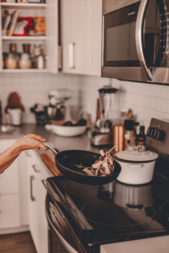 Midsection of preparing food at home