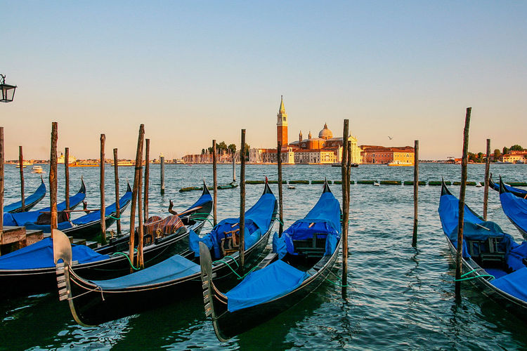 Architecture Blue Building Exterior Built Structure Canal Clear Sky Day Gondola Gondola - Traditional Boat Mode Of Transport Moored Nature Nautical Vessel No People Outdoors Place Of Worship Religion Sky Spirituality Transportation Travel Destinations Water Waterfront Wooden Post