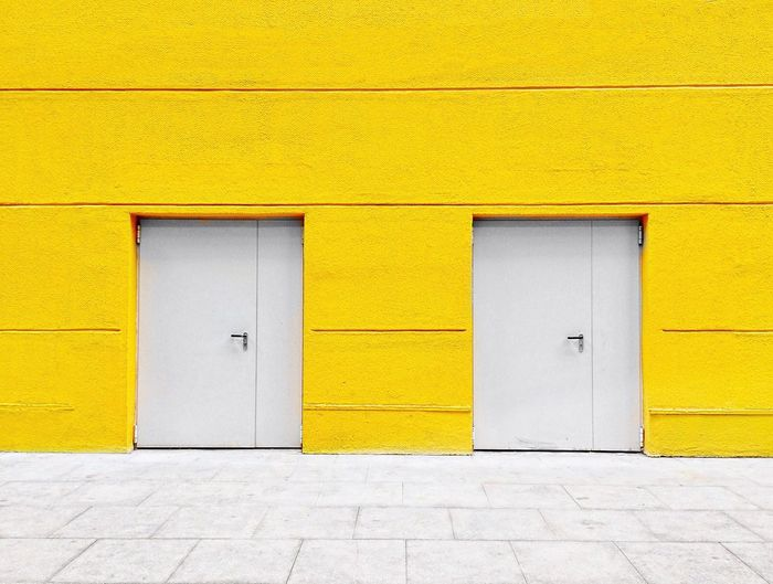 Yellow wall EyeEm Selects Architecture Built Structure Yellow Building Exterior No People Door Wall