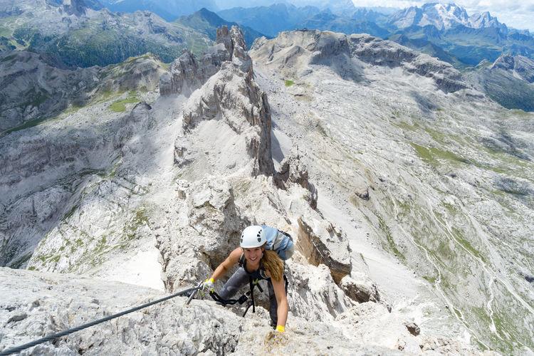 Portrait of woman climbing mountain