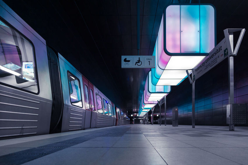 U-Bahnhof HafenCity Universität The Architect - 2018 EyeEm Awards Architecture Building Building Exterior Built Structure City Communication Direction Illuminated Mode Of Transportation Night No People Outdoors Public Transportation Rail Transportation Railroad Station Sign Text Train Train - Vehicle Transportation Travel