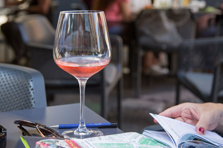 plan a city trip and what to do from a city guide with a glass wine on a terrace City Map Terrace Alcohol Business Chair City Trip Citytrip Planning Close-up Drink Drinking Glass Food And Drink Glass Human Hand Maple Leaf One Person Refreshment Restaurant Table Wine Wineglass