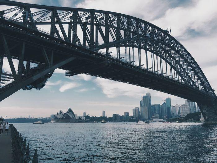 Sydney Harbor Bridge Over Thames River Against Sky