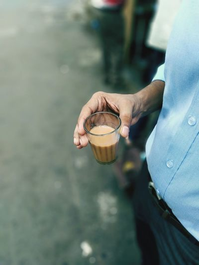 cup of tea at road side Tea Tea Time Tea Cup Street Photography Streetfood Human Hand Water Low Section Beach Sea Holding Midsection Women Close-up