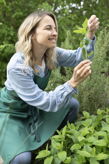 Smiling woman holding a plant