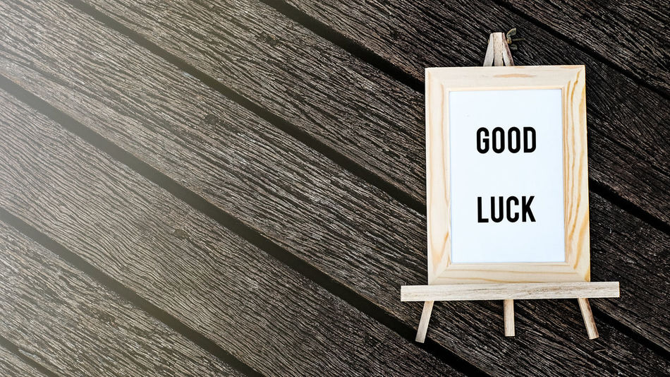 word good luck over wooden background Communication Concept Conceptual Conceptual Photography  Day Goodluck Information Sign No People Outdoors Road Sign Sign Text Typography Women Wood - Material Wording