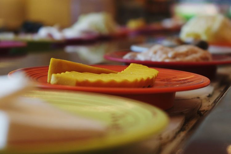 Close-up of orange slice in plate on table