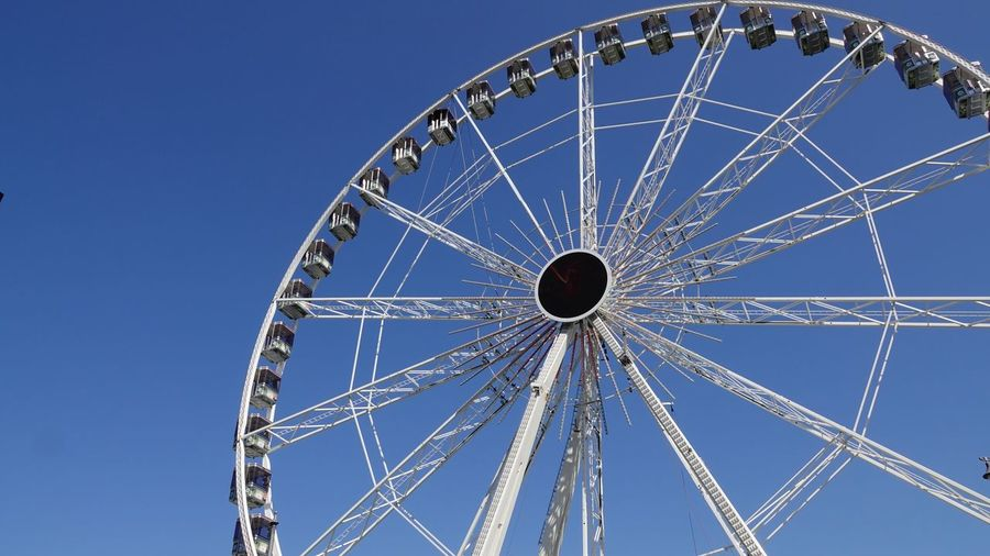 Antwerpen, Belgium Observation Wheel Nonbuilding Structures Sky Blue Low Angle View Ferris Wheel Nature No People Clear Sky Amusement Park Arts Culture And Entertainment Amusement Park Ride Geometric Shape Built Structure Pattern Architecture Fun Shape Circle Outdoors Close-up Day