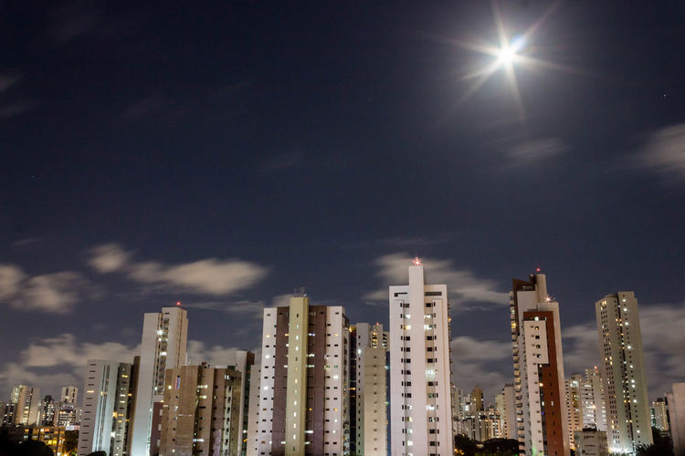 Sky Building Exterior Architecture City Built Structure Building Skyscraper Modern Cloud - Sky Illuminated Nature Tall - High Urban Skyline No People Night Residential District Outdoors Cityscape Moonlight