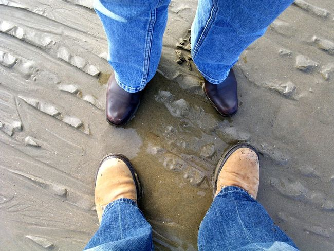 Friendship Meeting Male And Female Facing Each Other Standing On A Beach Date View Of Legs And Feet Only People Togetherness Jeans Denim Casual Clothing Love Daytime Outdoors Horizontal Adults Personal Perspective Conceptual