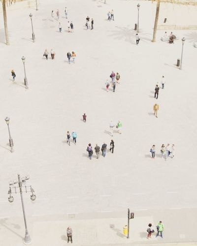 High angle view of people playing in city