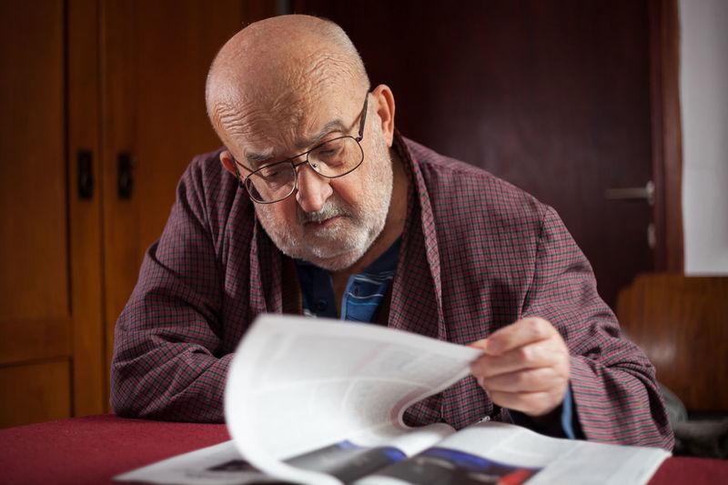 Close-up of senior adult reading