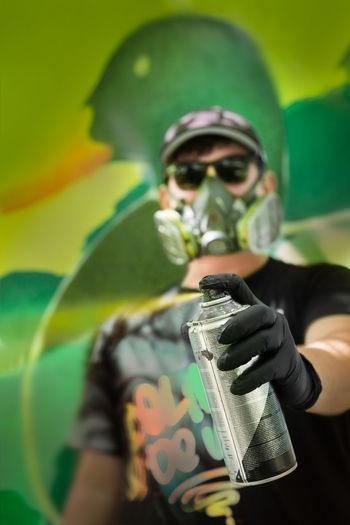 Portrait of man holding spray bottle