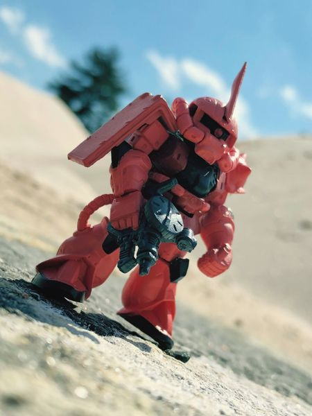Zaku Gundamconverge Gundam Sand Japanese Toy Forced Perspective Nature Sky Day Focus On Foreground No People Close-up Sunlight Toy Cloud - Sky Low Angle View