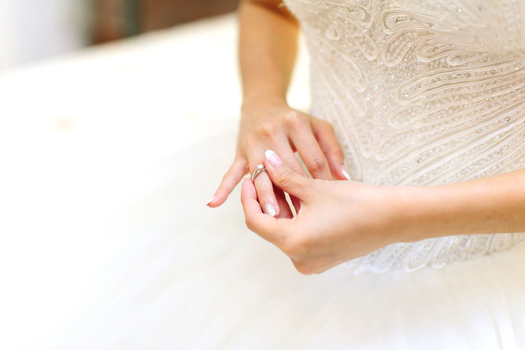 Midsection Of Woman In Dress Wearing Ring