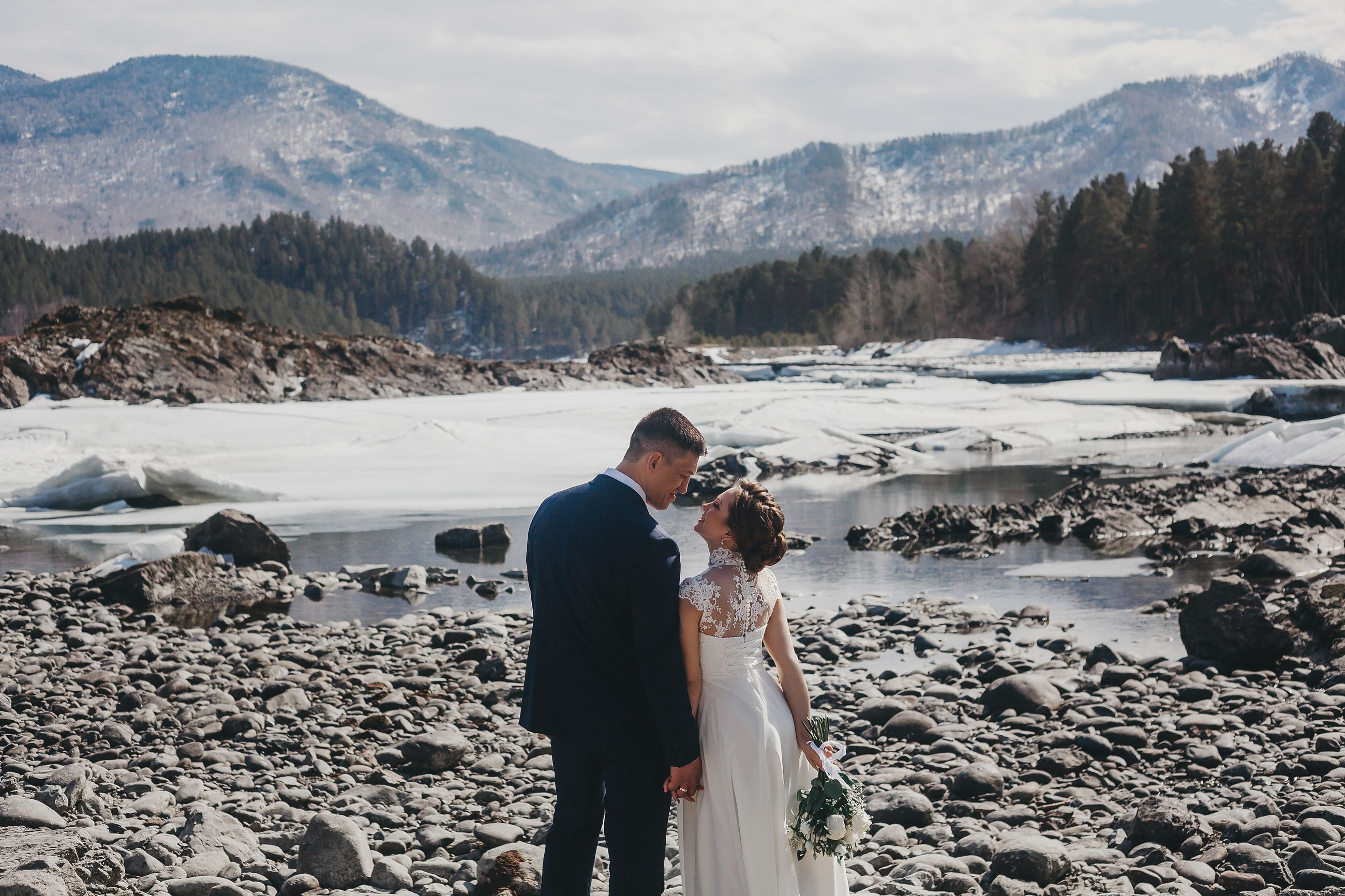 snow, cold temperature, real people, winter, two people, men, couple - relationship, women, love, togetherness, mountain, beauty in nature, standing, scenics - nature, nature, adult, bonding, non-urban scene, wedding, positive emotion, outdoors
