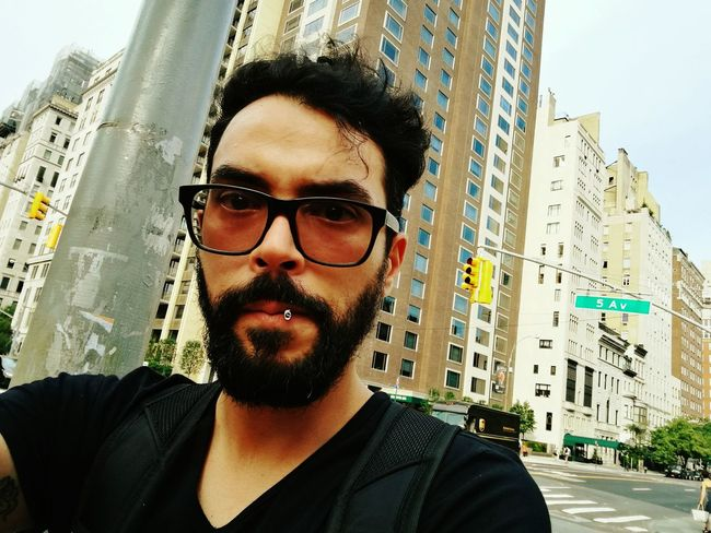 City Eyeglasses  Young Adult Beard Portrait One Person Outdoors City Life One Young Man Only Headshot One Man Only Young Men Men Day Building Exterior People 5th Avenue, NYC