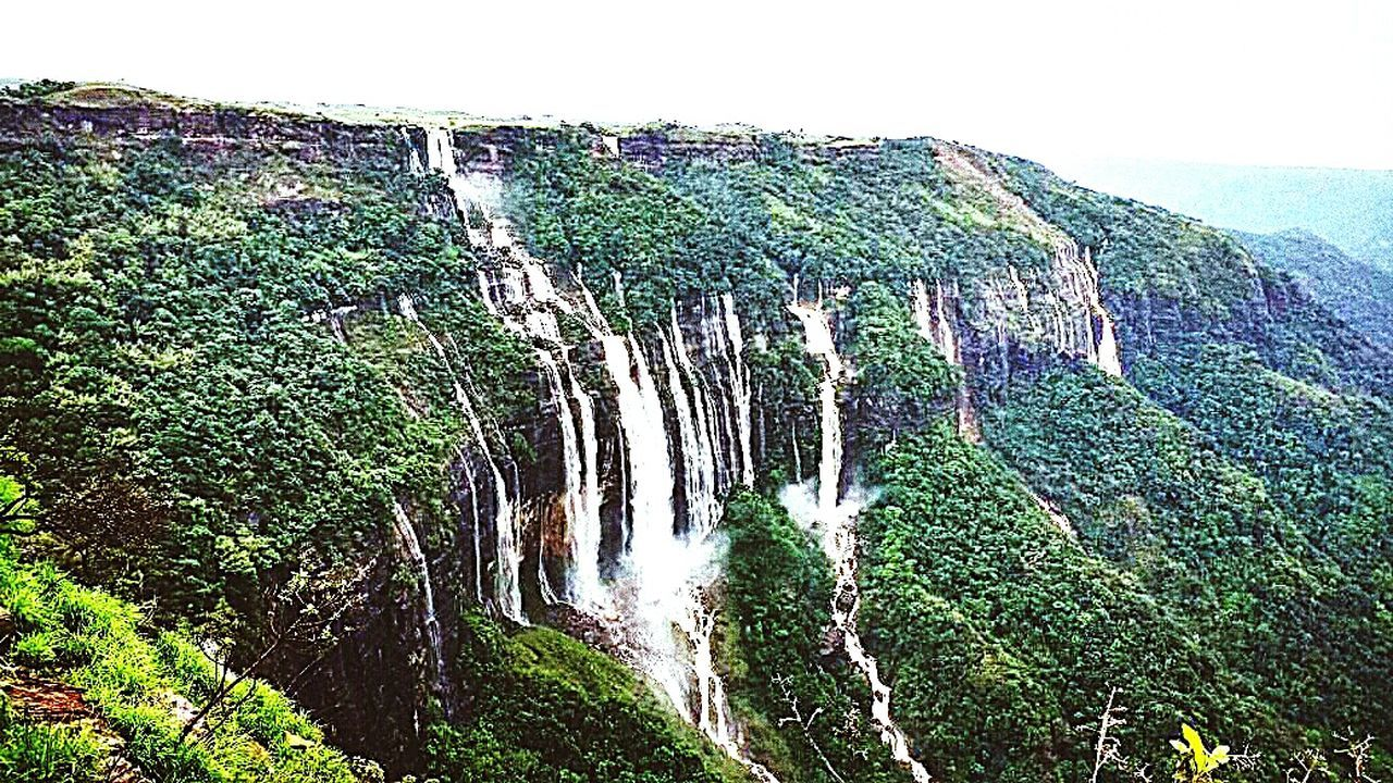 nature, beauty in nature, scenics, cliff, no people, rock - object, outdoors, waterfall, day, water, mountain, sky