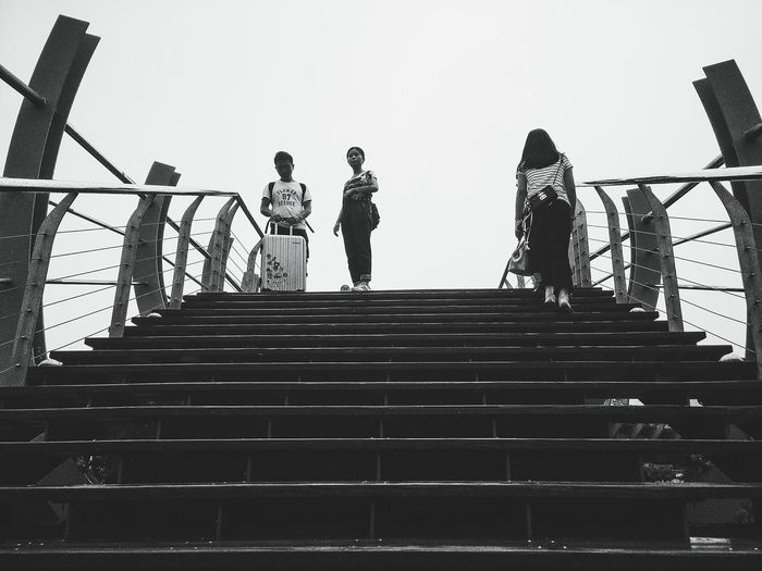 Steps And Staircases Steps Low Angle View Staircase Built Structure Architecture Moving Up The Way Forward Stairway Outdoors Stairs Bridge Black And White Hi! Taking Photos Street Streetphotography Person EyeEm Gallery People EyeEm Hello World Hanging Out Looking Up From My Point Of View