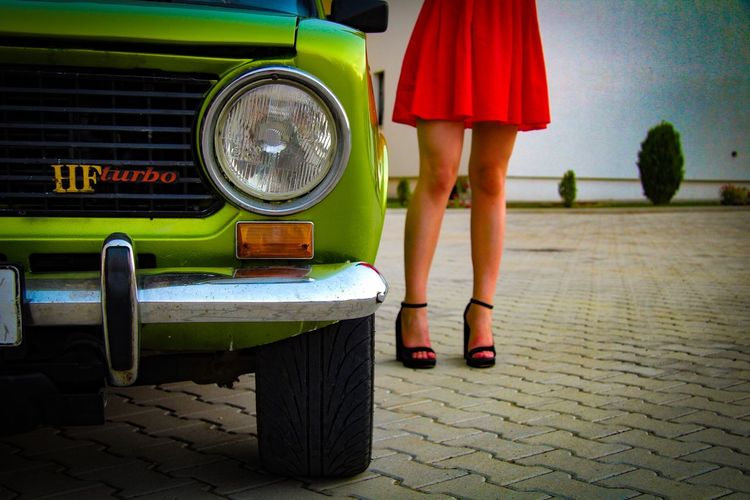 Beauty and the beast! Lancia LADA Wonderwoman Tokyo Paris New York Berlin Human Leg One Woman Only High Heels Old-fashioned Red And Green Dress Turbo Low Angle View Covergirl Woman In Red Sexygirl Oldtimer Oldschool The Week On EyeEm Fashion Stories The Fashion Photographer - 2018 EyeEm Awards The Creative - 2018 EyeEm Awards