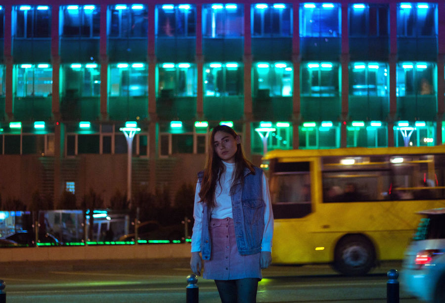 Adult Adults Only Casual Clothing City Front View Happiness Illuminated Looking At Camera Night One Person Outdoors People Portrait Real People Smiling Standing Transportation Young Adult Young Women