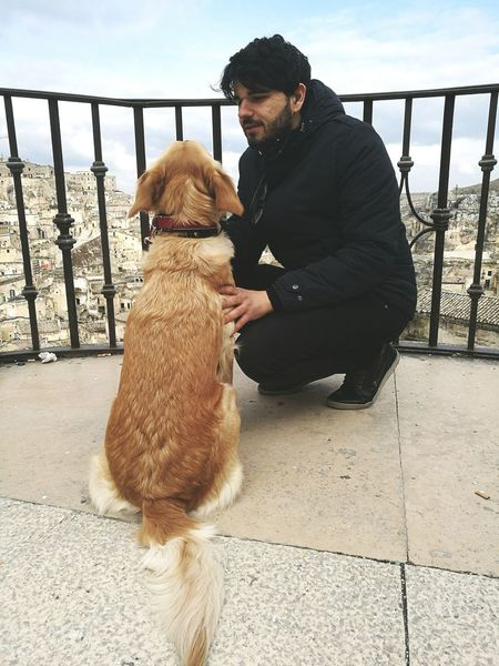 Matera Italy Matera Matera2019 One Animal Pets Dog One Person Teddy Bear Animal Full Length Love Animal Themes Mature Adult Domestic Animals Holding Looking Down Poodle Mammal One Man Only People Adults Only Adult Nature Matera, Italy Adult Cityscape Architecture Built Structure This Is Masculinity