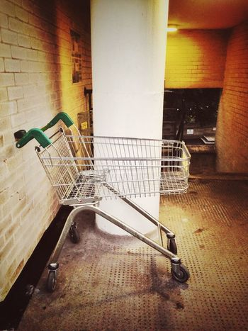 A supermarket trolley left abandoned at the top of a public stairwell. Architecture Railing Built Structure No People Evening Supermarket Trolley Abandoned Trolley Outside Footpath Concrete Stairwell Light Lighting Antisocial Shopping Cart Day