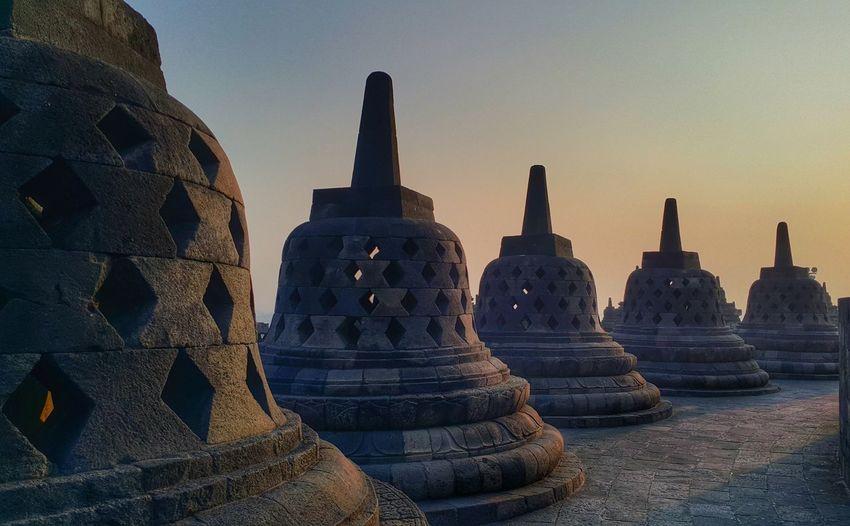 Stupas at borobudur against sky