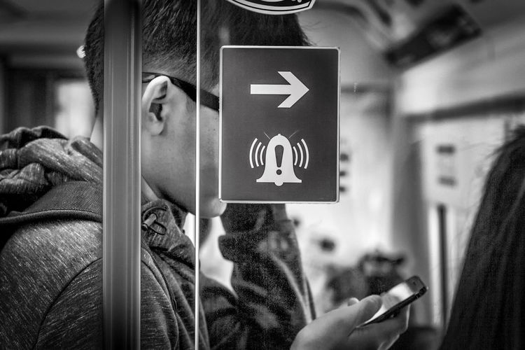 Follow the sign Black & White Blackandwhite Photography Close-up Communication Day Focus On Foreground Holding Human Hand Mobile Phone One Person Portable Information Device Real People Sign Signboard Smart Phone Technology Wireless Technology The Street Photographer - 2017 EyeEm Awards