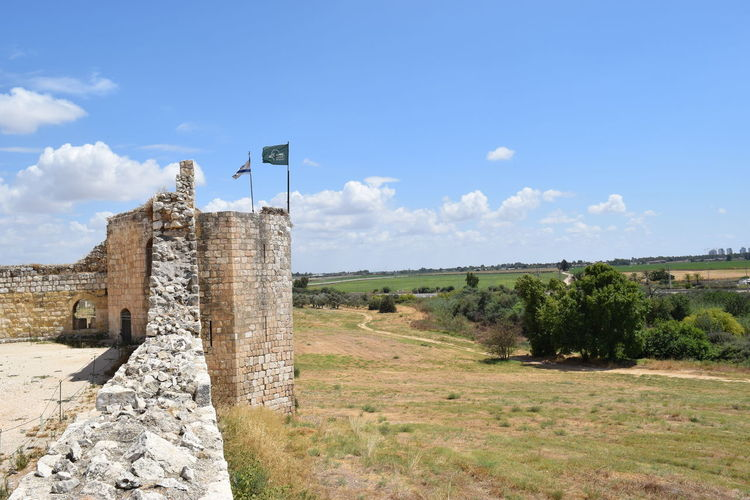 Historic Fort By Landscape Against Sky
