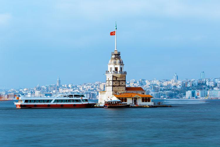 Ship in sea against buildings in city kiz kulasi