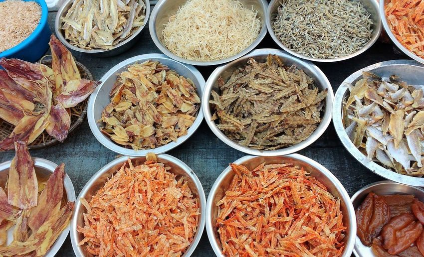 High angle view of food in bowls for sale at market stall