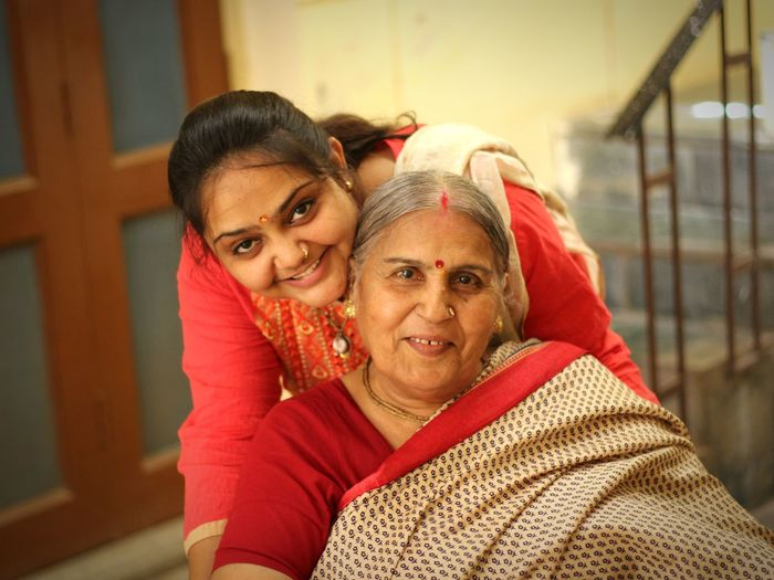 Portrait of happy grandmother with granddaughter
