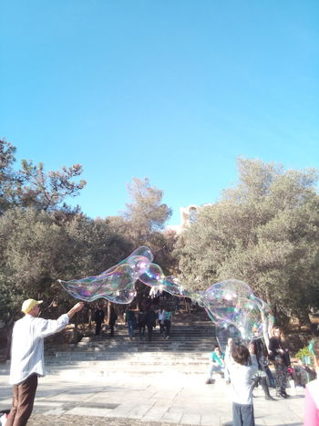 Fun Enjoyment Men Leisure Activity Large Group Of People Real Peo Bubbles Bubbles... Bubbles...Bubbles.... Summer Lifestyles Motion Women Outdoors People Vacations Togetherness Sky Day Clear Sky Spraying