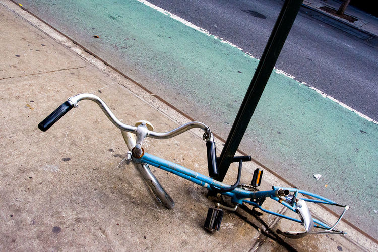 Stripped down bicycle on Stanton Street near Forsythe Street, Lower East Side, downtown Manhattan, New York. Bicycle Blue Day Defunct Downtown High Angle View Lower East Side No People Outdoors S Sidewalk Stanton Street Street Street Photography Streetphotography