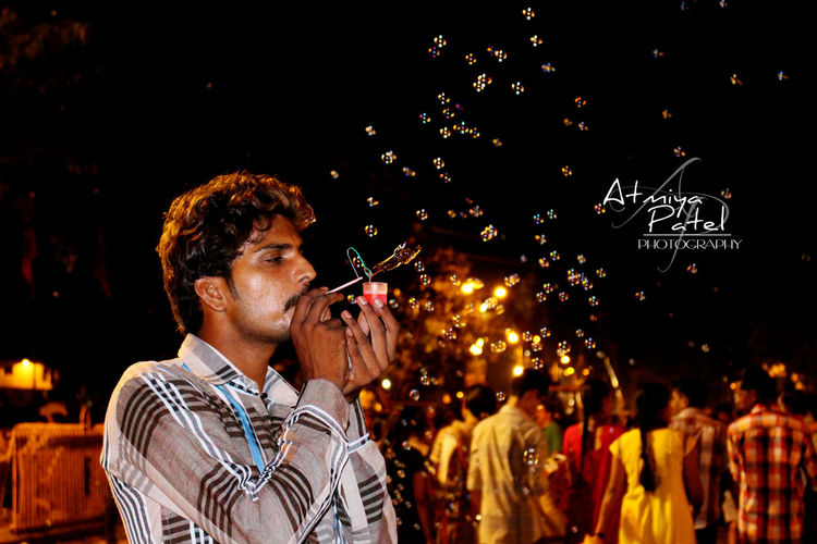 Blowing Bubbles Bubbles In The Air Canonphotography Citylight Hardtimes Men At Work  Night Streetphotography Struggler