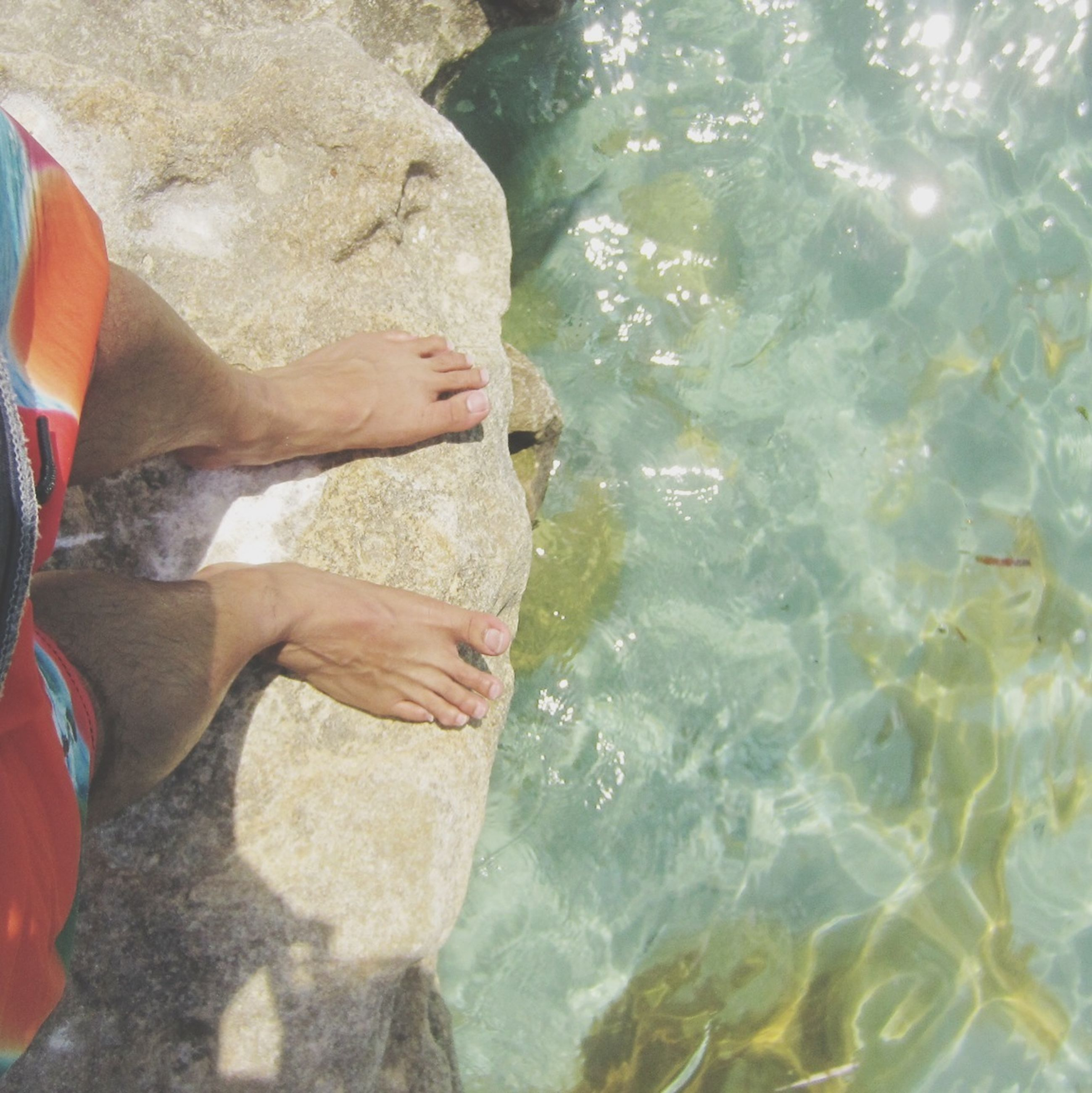 water, lifestyles, leisure activity, high angle view, swimming, low section, men, person, sunlight, vacations, sea, barefoot, day, outdoors, waterfront, rippled, relaxation