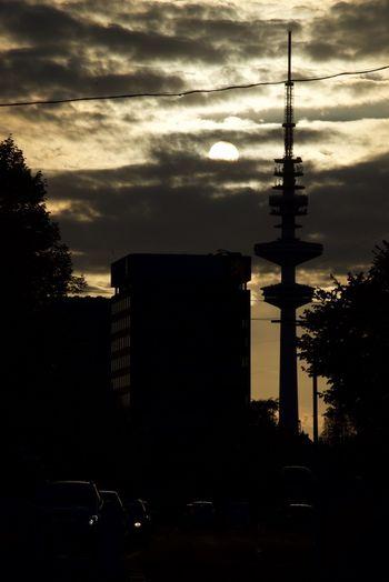 Fernsehturm/TV Tower, Hamburg Against The Sun Architecture City Cloud - Sky Contrast Dark Day Fernsehturm Hamburg Heinrich-Hertz-Turm Nature No People Outdoors Silhouette Silhouette Sky Sunset Tree