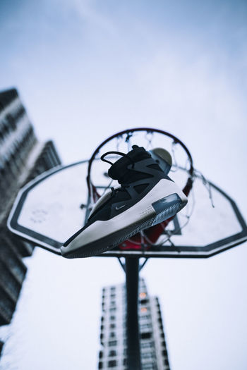 Low Angle View Building Exterior Sky Architecture Lighting Equipment Focus On Foreground Technology Street Outdoors No People Street Light Day Nike EyeEm Best Shots EyeEm London City Streetphotography Basketball Hoop Sneakers Fashion Tower Block  Low Angle View Colors Tall - High
