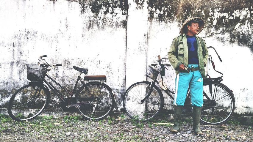 Bicycle Mode Of Transport Old Transportation One Person Transportation Outdoors Cycling Real People One Man Only Adult Bicycle Basket Only Men Headwear Nature Adults Only Standing People Day Indonesian INDONESIA Old Man Traditional Transportation