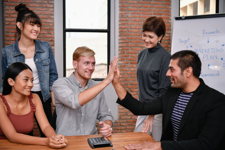 Hands Up Shake Hands Acclaim ARCHITECT Asian  Background Board Business Businessman Businesswoman Casual Business Caucasian Cheerful Colleague Conversation Coworker Dealing Designer  European  Fun Funny Glad Guide Happiness Happy High Five Jubilant Lifestyle Man Manager Market Meeting Office Partner People Personal Present Professional Smiling Success Successful Successfully Suggest Team Teamwork Togetherness Woman Work Worker Young Adult