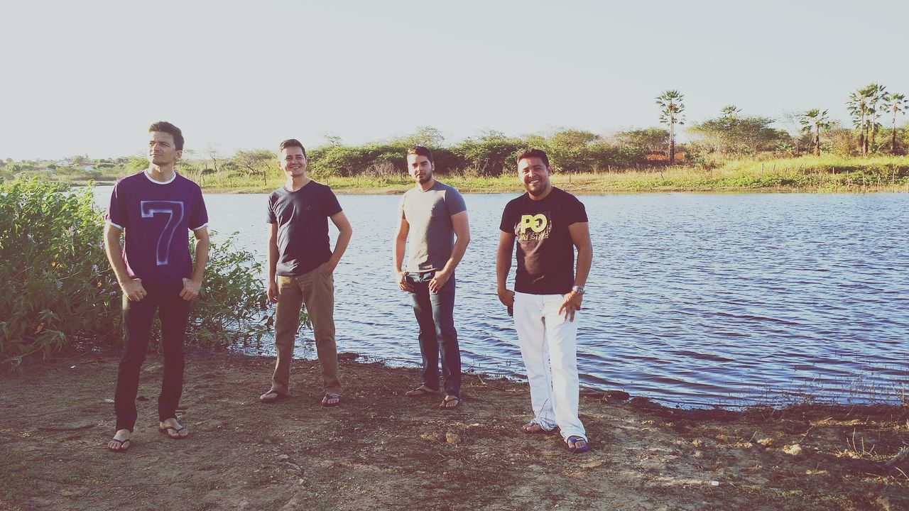 standing, real people, nature, togetherness, day, tree, outdoors, sky, portrait, looking at camera, full length, men, landscape, clear sky, beauty in nature, friendship, water, grass, young adult, people